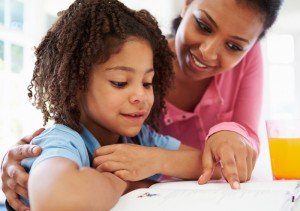 Mom_helping_girl_with_homework_kitchen_700x493