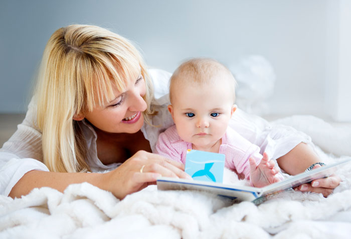 Mom_Baby_Reading_Flap_Book_on_Quilt