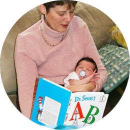 Reading a Dr. Seuss book to a newborn