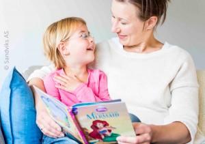 girl_mom_reading_disney_littlemermaid_book_700x493