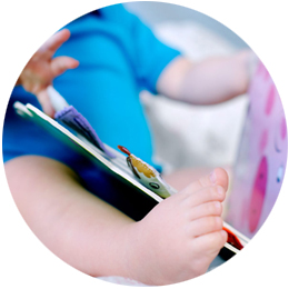 Baby playing with a flap board book