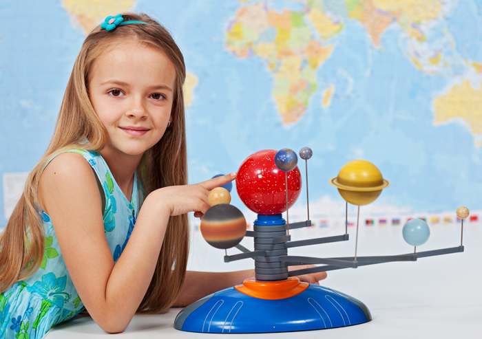 girl_doing_science_project_700x493.jpg