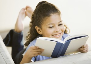 girl_reading_book_independently_700s493