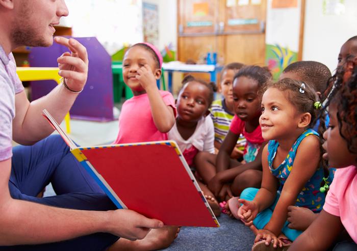 Teacher Reading to Kindergarten Students