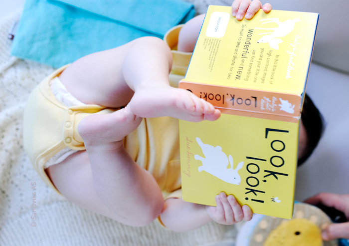 baby_reading_on_back_700x493