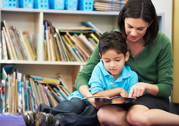 Mom enjoying the emotional rewards of reading aloud to her son at the library