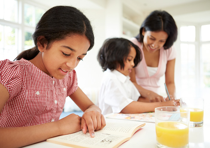 Benefits of reading aloud at the breakfast table with mom and two kids