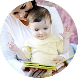 Baby excited by a book