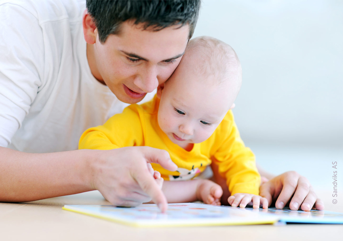 father_reading_with_baby_pointing_700x493