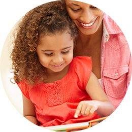 girl and mom reading