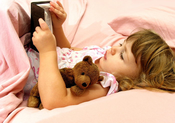 Girl reading a bedtime story