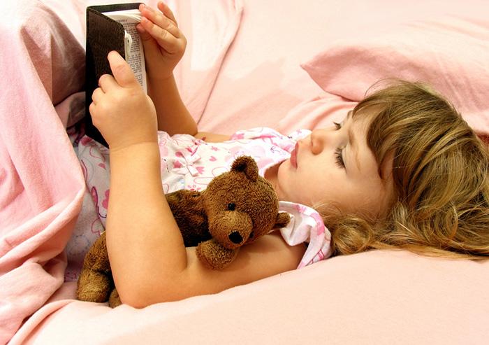 Girl reading a bedtime story