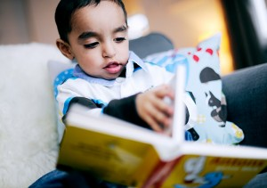 2-year-old reading a book