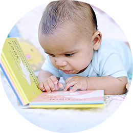 Baby looking at a board book