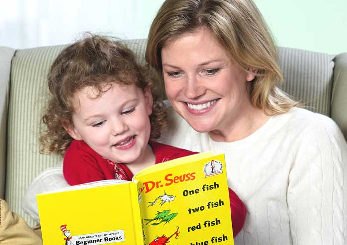 little_girl_reading_dr_seuss_with_mom_700x493