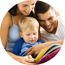Mom and dad reading to their toddler