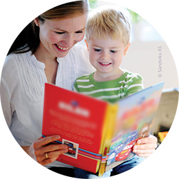 Mom and boy reading a Disney book