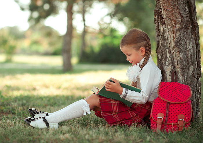 6-year-old girl enjoying the emotional Rewards of Reading Aloud