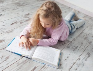 Girl_reading_a_just_right_book_700x493