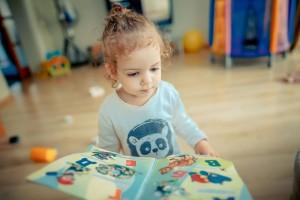 Little_girl_reading_book_700x493