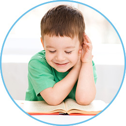 preschooler reading from a book