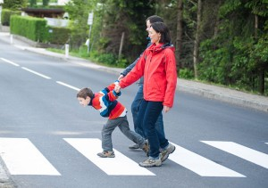 hyperactive_boy_pulling_his_parents_across_the_street_700x493