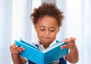 Preschool boy learning to read