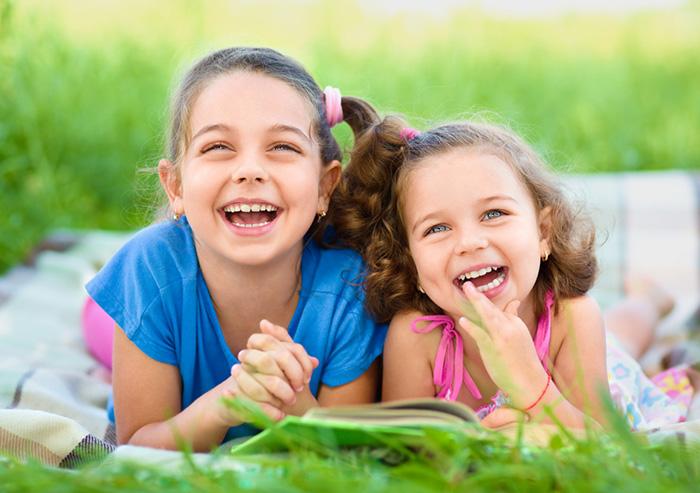 Two girls enjoying summer reading fun