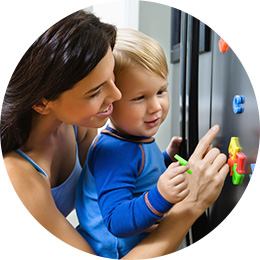 mother and boy playing with magnetic letters