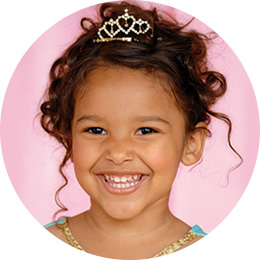 girl with tiara, dressed like a Disney Princess