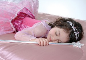 Girl dressed as a Disney Princess sleeping