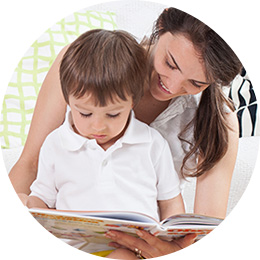 mother and her son practicing good reading skills