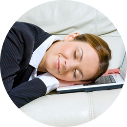 Working mother asleep on her computer
