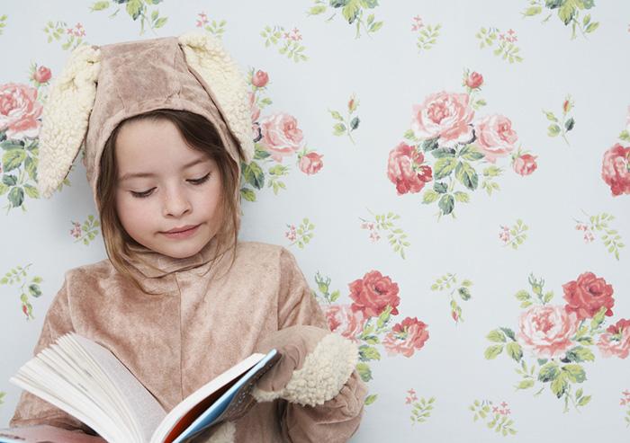 Girl in bunny costume reading