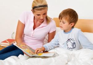 Mom reading to boy