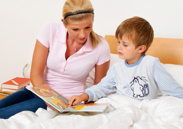Mom reading to boy