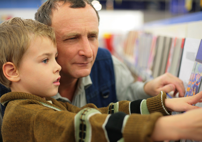 father and son at bookstore