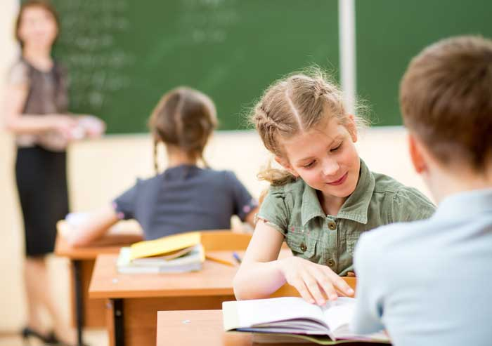 Girl doing school work in the classroom