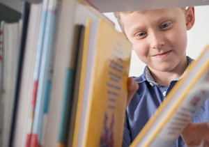 Boy looking at favorite books