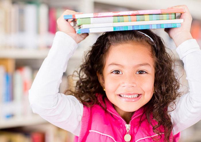 Girl holding library books