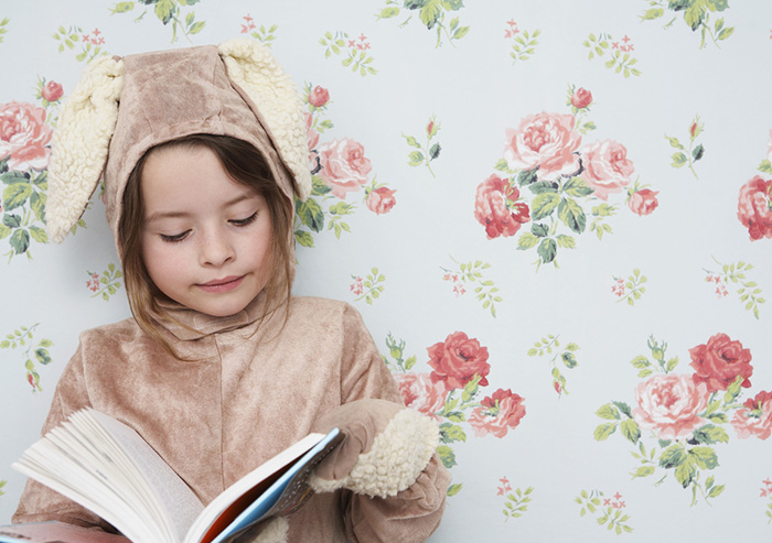girl_reading_in_bunny_costume_700x493